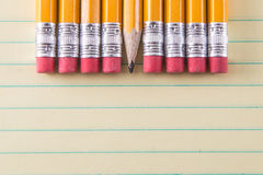 Yellow Pencils & Erasers on Paper Stock Images
