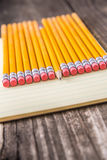 Yellow Pencils & Erasers on Paper Stock Photo