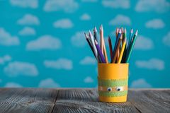 Yellow Pencils Holder With Colorful School Supplies On A Wooden Royalty Free Stock Photography