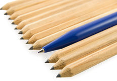Yellow pencils lined obliquely with one pen. On white background Stock Photos