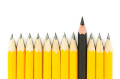 Yellow pencils with one black pencil. Yellow pencils with on black pencil on white background Royalty Free Stock Photo