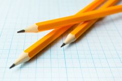 Yellow pencils on paper for drawings, empty space stock images
