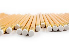 Yellow pencils upside down. Row of yellow pencils upside down Royalty Free Stock Photo