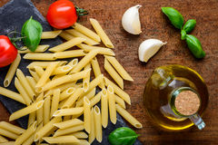 Yellow Penne Pasta and Cooking Ingredients Royalty Free Stock Photography