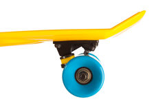 Yellow penny skateboard part on white Stock Images