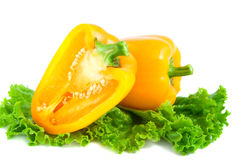 Yellow pepper. Yellow peppers and salad leaf  on a white background Royalty Free Stock Images