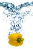 Yellow pepper falls deeply under water Royalty Free Stock Photography