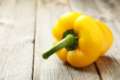 Yellow pepper on the grey wooden background Royalty Free Stock Photography