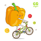 Yellow pepper rides a bicycle Stock Photo
