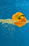 YELLOW PEPPER SPLASHING IN WATER Stock Photo