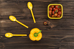 Yellow pepper standing in the middle of the table Royalty Free Stock Image