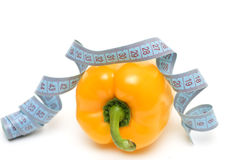 Yellow pepper with a tape measure(conceptual diet) Royalty Free Stock Photo
