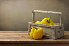 Yellow pepper in wooden box Royalty Free Stock Photos