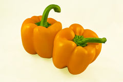 Two yellow peppers. A pair of sweet yellow peppers on a white background Royalty Free Stock Photography