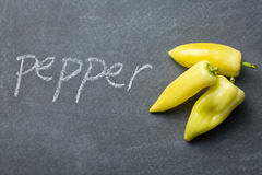 Yellow peppers on chalkboard Stock Photo