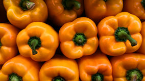 Yellow peppers stacked Royalty Free Stock Photo