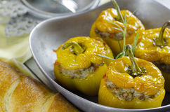 Yellow peppers. Stuffed with meat and rice in rustic metal bowl Stock Image