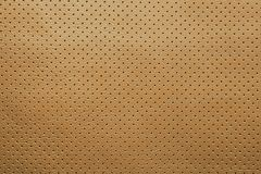 Yellow perforated leather texture background royalty free stock photography