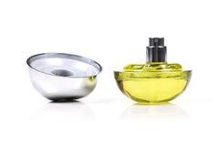 Yellow perfume bottle Stock Images