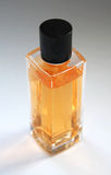 Yellow perfume bottle Stock Image