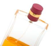 Yellow perfume bottle isolated on white Royalty Free Stock Photos