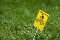 Yellow Pesticide Application Warning On Green Lawn royalty free stock photography
