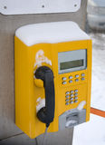 Yellow phone booth Stock Photos