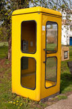 Yellow phone booth Royalty Free Stock Photography