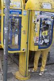 Yellow phone booth in Athens stock image