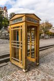 Yellow phone booth Royalty Free Stock Photos