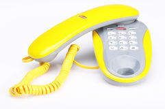 Yellow phone on white Royalty Free Stock Photo
