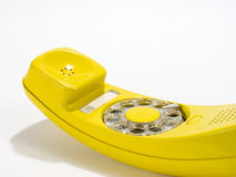 Yellow phone2. Yellow rotary telephone off the hook and facing up stock photography