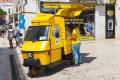 Yellow Piaggio Ape three-wheeled vehicle. Lisbon, Portugal - August 12, 2017: Yellow Piaggio Ape three-wheeled light commercial vehicle as a touristic Stock Photo