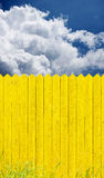 Yellow picket fence Stock Photo