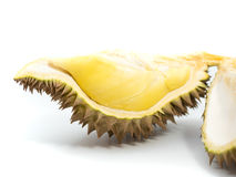 Yellow piece of durian with green and brown peel on white background Royalty Free Stock Photos