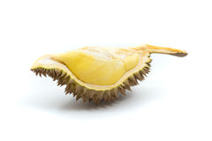 Yellow piece of durian with green and brown peel on white background Royalty Free Stock Image