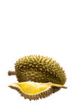 Yellow piece of durian with green and brown peel, and whole one with sharp thorn on back, isolated on white Royalty Free Stock Photography