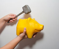 Yellow pig moneybox and hummer Royalty Free Stock Photos