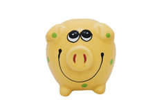 Yellow piggy. Piggy bank on white background center Stock Photos
