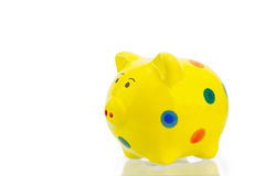 Yellow piggy bank Stock Images