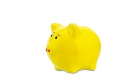 Yellow piggy bank Stock Image