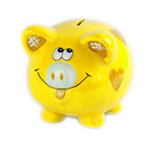 Yellow piggy bank style money box isolated on a white Stock Photo