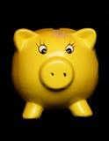 Yellow piggybank Stock Photos