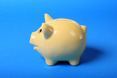 Yellow piggybank Royalty Free Stock Images