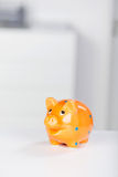 Yellow Piggybank On Desk Royalty Free Stock Photo