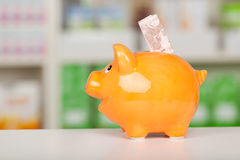 Yellow Piggybank With Euro Note On Pharmacy Counter Stock Photography