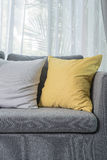 Yellow pillow on grey sofa in modern living room Royalty Free Stock Image