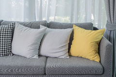 Yellow pillow on grey sofa in modern living room Royalty Free Stock Photos
