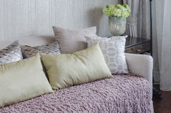 Yellow pillows on pink blanket on luxury sofa in living room Stock Photo