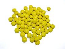 Yellow pills Stock Image